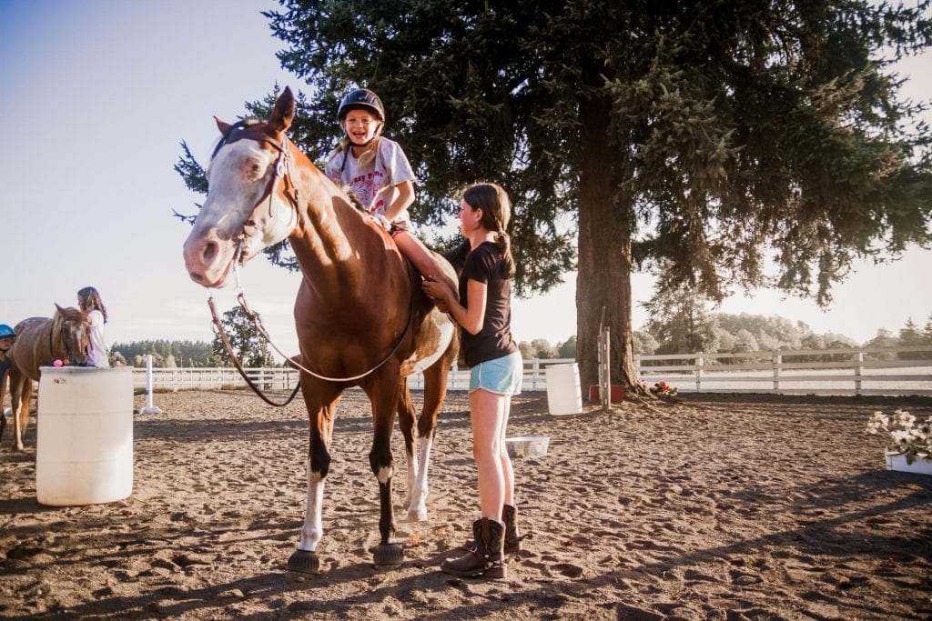 girl having fun riding bareback on a horse